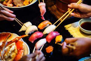 customers eating nigiri
